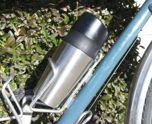 OXO Good Grips LiquiSeal Travel Mug in a bottle cage.
